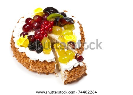 Cake with fruits and whipped cream. Isolated on white - stock photo