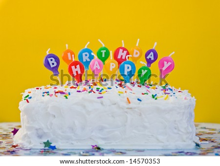 stock photo : Cake with happy birthday balloon shaped candles