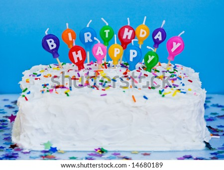 stock photo : cake with happy birthday candles, blue background
