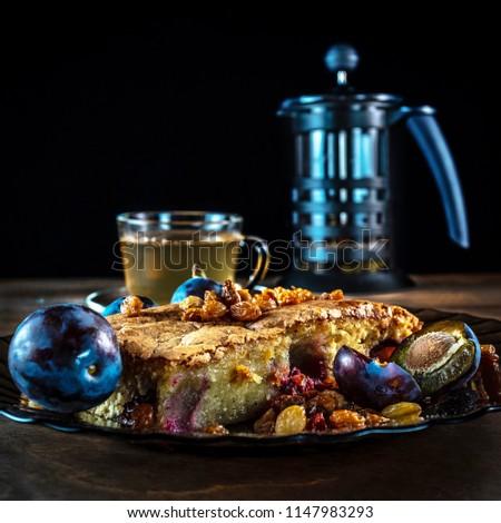 Cake with plum and raisins #1147983293