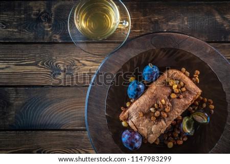 Cake with plum and raisins #1147983299