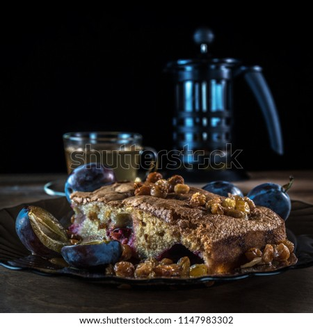 Cake with plum and raisins #1147983302