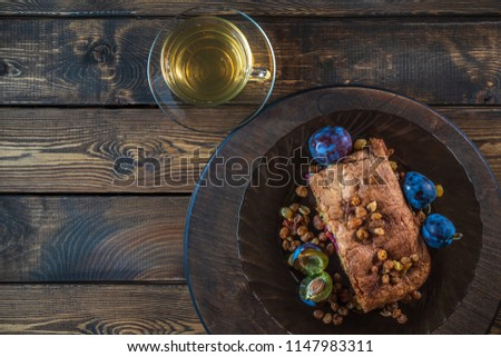 Cake with plum and raisins #1147983311