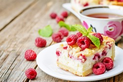 cake with raspberries and cream cheese decorated with fresh raspberries and mint. the toning. selective focus