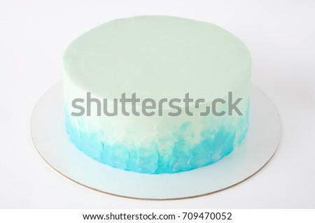 Cake with whipped blue cream. Picture for a menu or a confectionery catalog. Close up