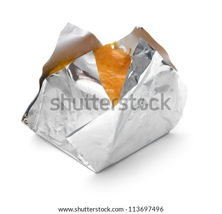 cake wrapped in foil isolated white background