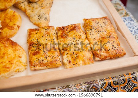 cakes with poppy seeds and sesame seeds. cakes with poppy seeds and sesame seeds on a store counter. street food