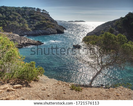 Cal d en Monjo bay  between  Peguera, Calvia and Andratx, Majorca island, Spain. Blue water in cirlce bay in hiden in deep rocks. Stock fotó ©