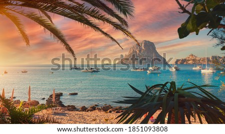 Cala d'Hort beach. Cala d'Hort in summer is extremely popular, beach have a fantastic view of the mysterious island of Es Vedra. Ibiza Island, Balearic Islands. Europe, Espana, Spain