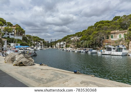 Cala Figuera, Santanyí, Mallorca, Spain. August 9, 2017. It is a port of traditional fishermen, with its small houses, piers, with fishing boats and nets drying in the sun.