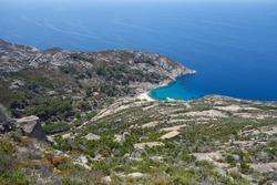 Cala Maestra beach at Island of Montecristo (formerly Oglasa) in the Tyrrhenian Sea part of the Tuscan Archipelago in Portoferraio, Italy