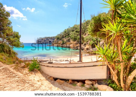 Cala Portals Vells Calvia Mallorca Majorca Spain old ship with palms and turquoise mediterranean sea