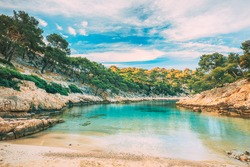 Calanques, Cote de Azur, France. Beautiful nature of Calanques on the azure coast of France. Calanques - a deep bay surrounded by high cliffs. Landscape in sunrise light during Sunny summer morning.