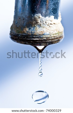 calcified dripping faucet isolated