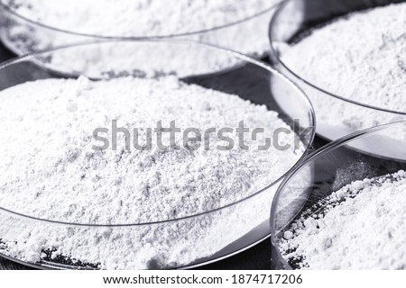 Calcium carbonate, the result of the reaction of calcium oxide with carbon dioxide. Being prepared in petri dish Stock photo ©