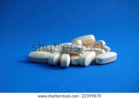 Calcium Pills on Blue Background