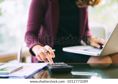 calculate,finance,accounting,Business people analyzing investment charts with calculator .Accounting technology,using laptop at office,Analyze plans document paper graph chart business marketing plan.