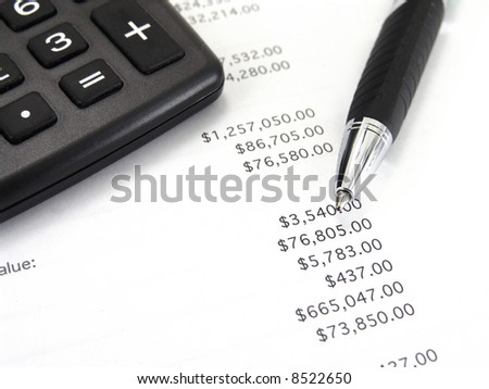 calculator and balance sheet with pen