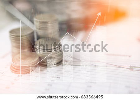 Shutterstock Calculator and coin,money with business graphs and charts report on table, calculator on desk of financial planing. Financial bank concepts.