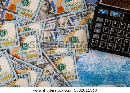 Calculator and 100 dollars accounting calculating cost economic