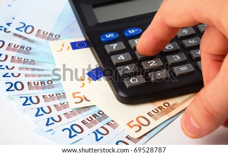 Calculator and few Euros - accounting concept