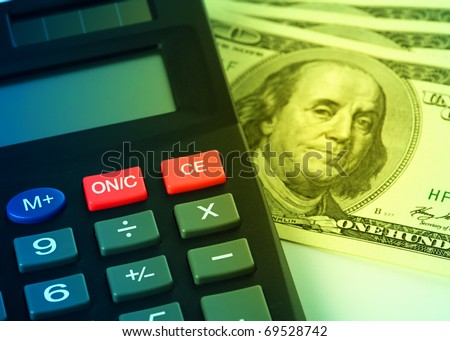 Calculator and few hundred dollars - accounting concept
