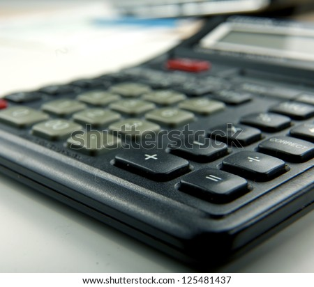 Calculator and laptop