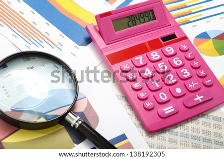 Calculator and magnifier on a business background