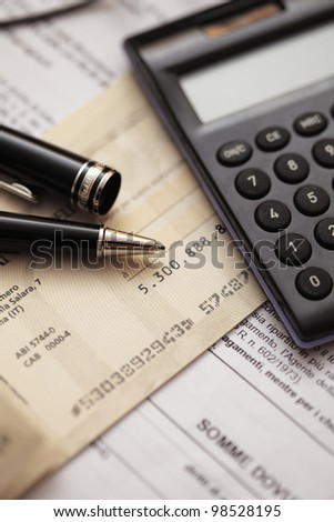calculator and paper on an office desk