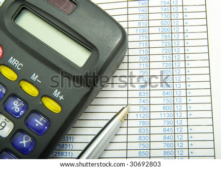 calculator and pen - stock photo