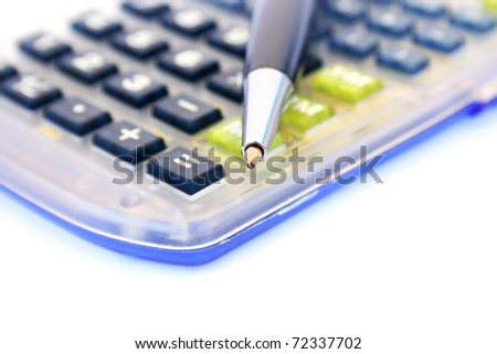 Calculator and pen isolated on white background.
