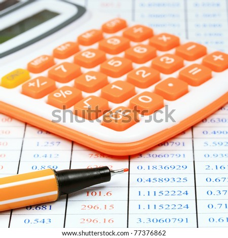 calculator and pen on a table of business background