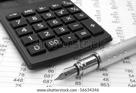 calculator and pen on a white background