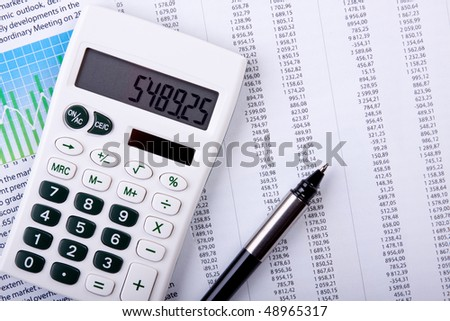 Calculator and pen on calculates