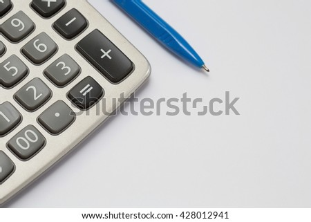 Calculator and pen on white background with copy space,(Selective focus),Financial concept.