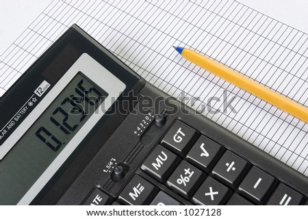 Calculator and pencil. Nice closeup, no dust or scratches.