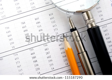 calculator and stationery items on the table