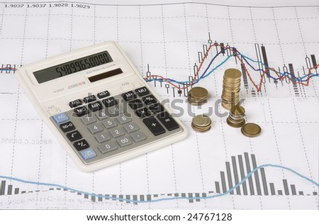 calculator, coins, pen on Economic graph showing success and economic growth