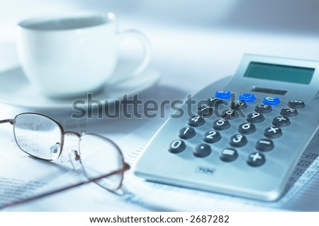 Calculator,glasses and coffee mug