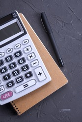 Calculator keypad on a beton floor background. Top view. Copy space