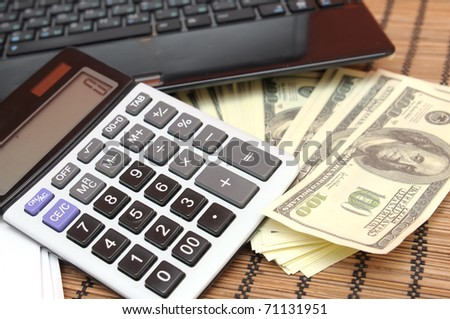 Calculator, money and computer