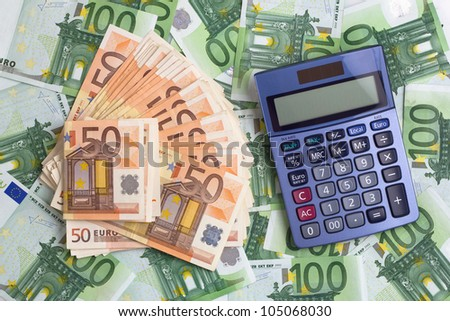 calculator on a background with euros banknotes - stock photo