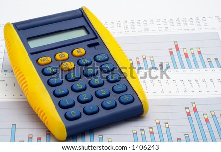 Calculator on earnings chart background