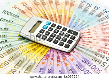 calculator on euro banknotes background