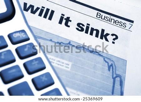 Calculator on news paper close up
