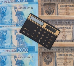 Calculator on the background of tsarist and modern Russian banknotes
