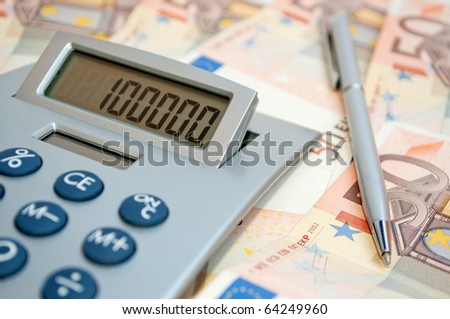 Calculator on the fifty euro banknotes - stock photo