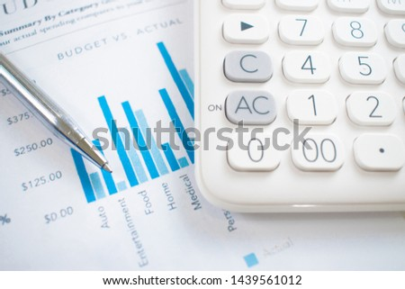 Calculator on the graph with the lowest graphing pen Financial graph business concept
