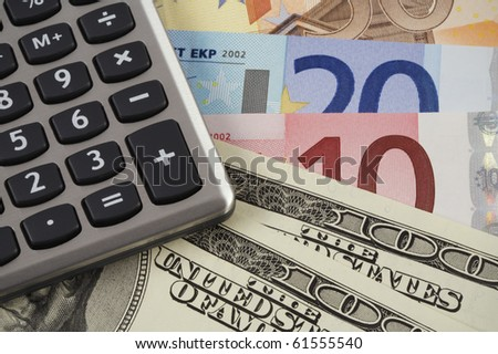 calculator on the U.S. dollar and the euro banknotes