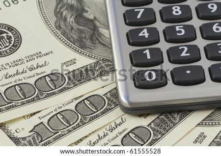 Calculator on US dollars background